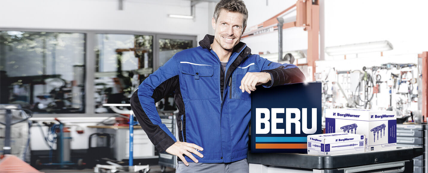 Man working in garage with BERU products