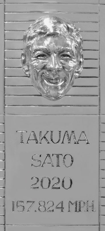 a single section of the Borg-Warner trophy featuring Takuma Sato's likeness in silver